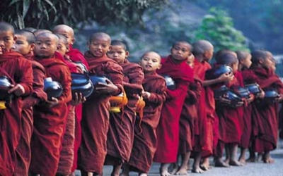 Novice monks out early for breakfast